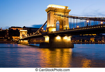 The Chain Bridge in Budapest lit by the street lights
