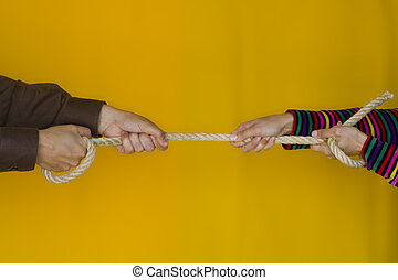 The Challenge - A man and a woman stretching a rope