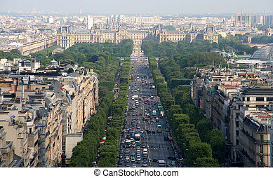 The Champs Elysee and the Louvre in the distance, seen from the roof of the Arc de Triomphe