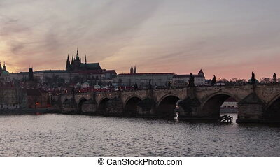 The Charles bridge and time lapse zoom out shooting in day-to-night perspective