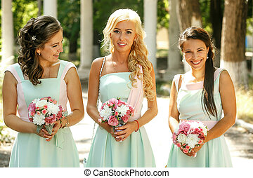 The charming bridesmaids with bouquet