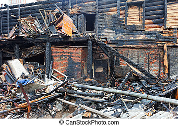 The charred ruins and remains of a burned down house.