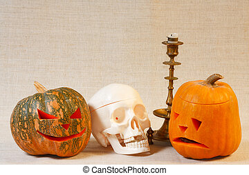 The cheerful and sad halloween pumpkin and skull from canvas...