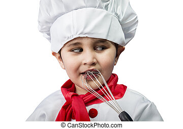 The cheerful little boy in a suit of the cook costs