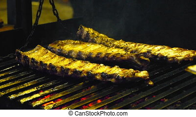 Appetizing ribs on the grill, cooking barbecue meat, juicy lamb ribs with grilled crust on the grill