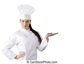 the chef - young graceful woman dressed as a cook with cap ...