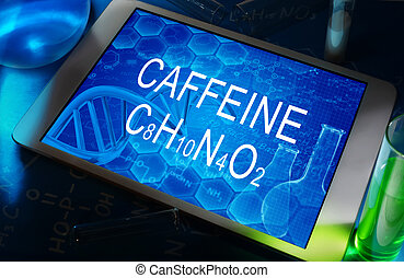 caffeine - the chemical formula of caffeine on a tablet with...