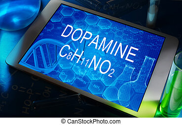 Dopamine - the chemical formula of Dopamine on a tablet with...