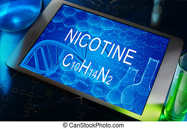 Nicotine - the chemical formula of Nicotine on a tablet with...