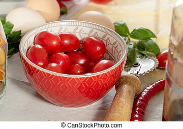 cherry tomatoes in a small red bowl