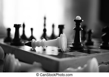 The chess pieces are placed on the chessboard. Defeated...
