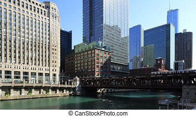 The Chicago Riverwalk and a transit train