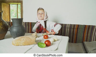 the child eats sitting at the table