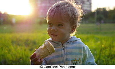 the child eats the ice cream on sunset