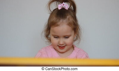 The child girl plays, indulges, hooligan and does not listen to parents and teachers. Preschool education