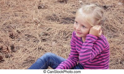 The child grimaces in nature