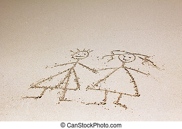 child has drawn - The child has drawn mum and daddy on sand