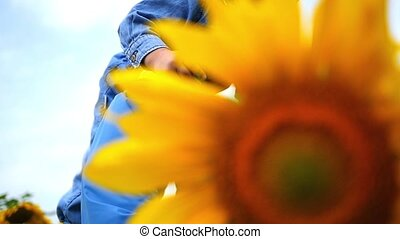 the child is happy in a field of flowers sunflower