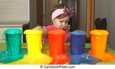 The child is studying colors.
