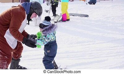 The child learns to ski with an instructor. Ski resort....