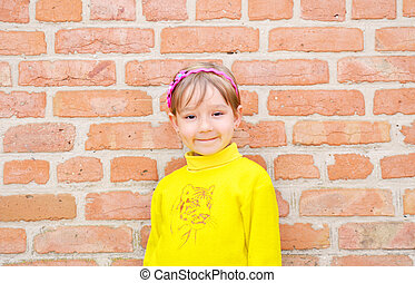 The Child on background brick wall