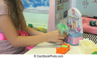 The child plays in kindergarten indoors - The child in...