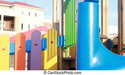 The child plays in the playground in different games in the...