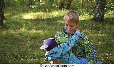 the child plays with his younger brother in the Park