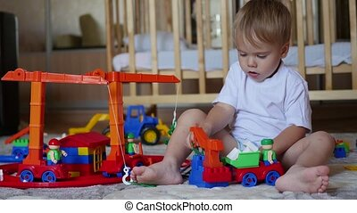 the child plays with the toys in the playroom