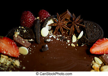 The chocolate cherry cake, decorated with strawberries, biscuits and strawberry shortcake. A masterpiece of culinary art