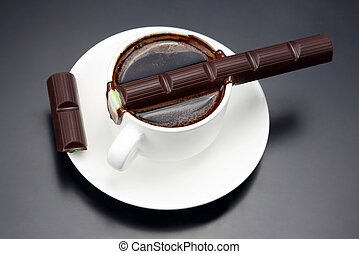 chocolate melted on white hot Cup with black coffee