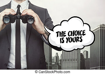 The choice is yours text on speech bubble with businessman holding binoculars
