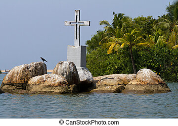 The Christian cross on a small island in backwaters