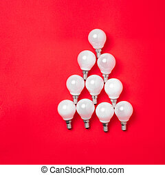 The christmas tree from lantern lamps laying on red...