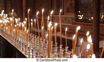 The Church Is Lit Many Candles Around The Icons. There Is...