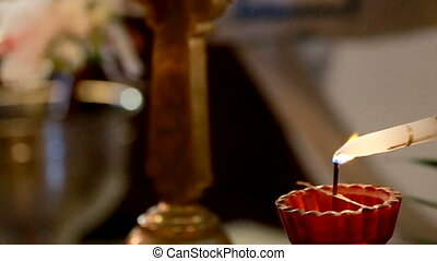 The church rite. Wedding ceremony. The priest lights candles...