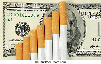 cigarettes - the cigarettes laying on american money. Cost ...