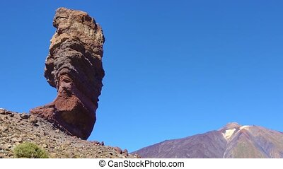 The Cinchado rock and the Teide volcano in Tenerife, Canary...