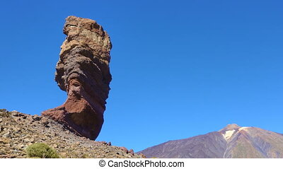 Tenerife - The Cinchado rock and the Teide volcano in...