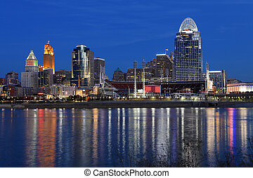 Cincinnati skyline after dark with reflections