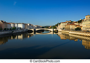 Image shows the river Saone running through the city of Lyon in France