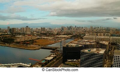 The city of Manila, the capital of the Philippines. Modern...