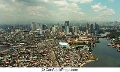 The city of Manila, the capital of the Philippines. -...