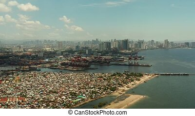 The city of Manila, the capital of the Philippines. - Sea...