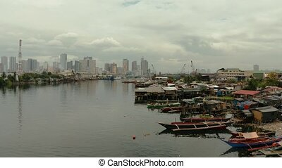 The city of Manila, the capital of the Philippines. - Shacks...