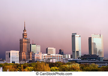 Warsaw, capital city of Poland cityscape, just before the sunset, featuring Palace of Culture and Science, Srodmiescie district.