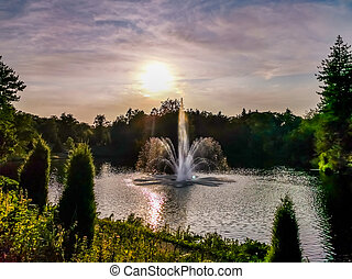 the city park berg en bos in apeldoorn, the netherlands, beautiful water fountain and colorful sunny sky