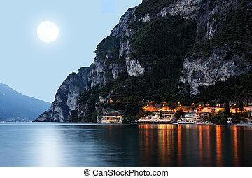 The city Riva del Garda by night.