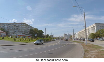 The city road with a weak traffic. - A wide city road, along...
