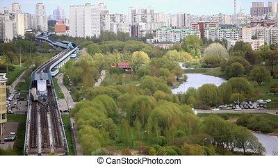 The city's skyline. Skytrain station and green Park